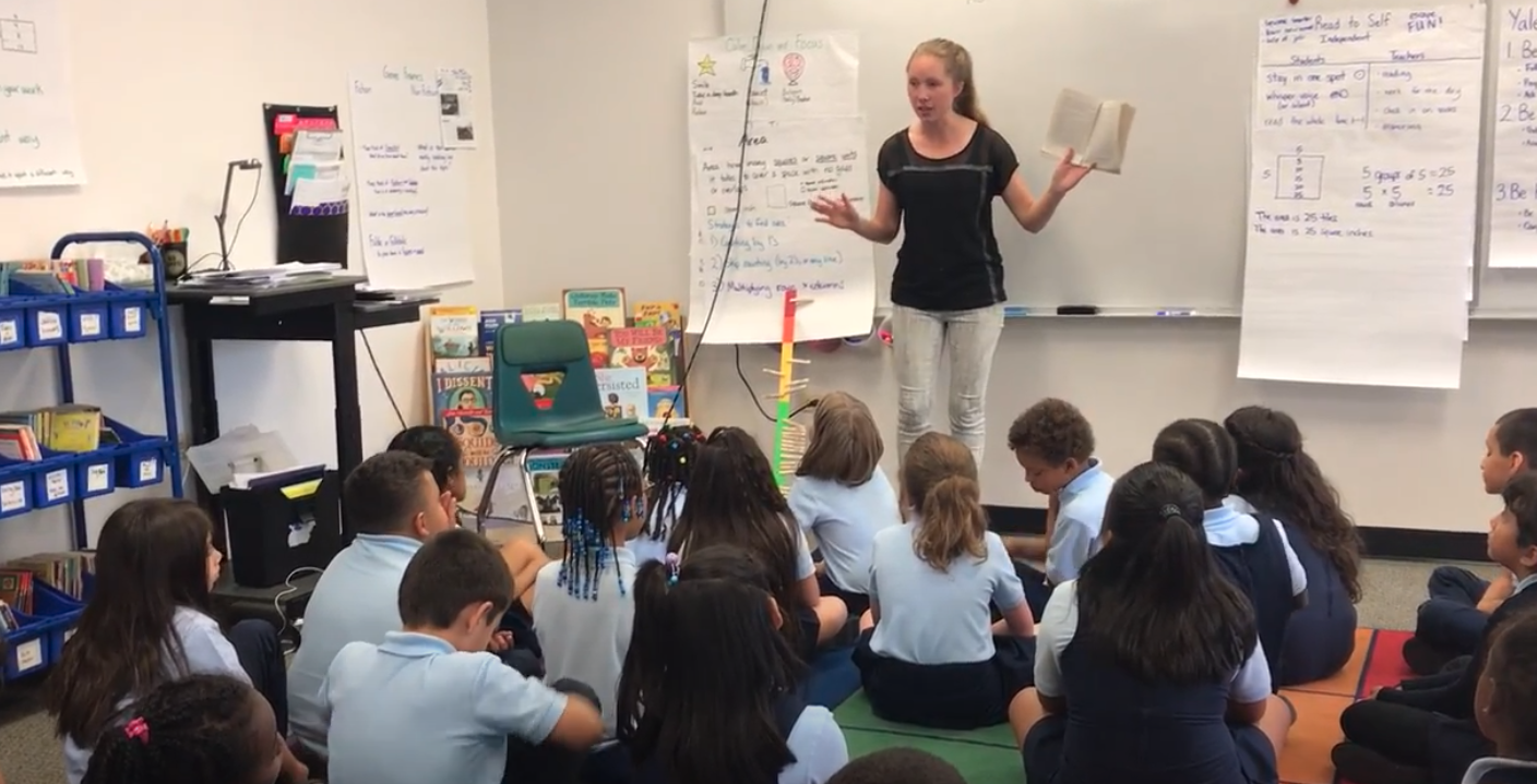 Katherine teaching a group of students.