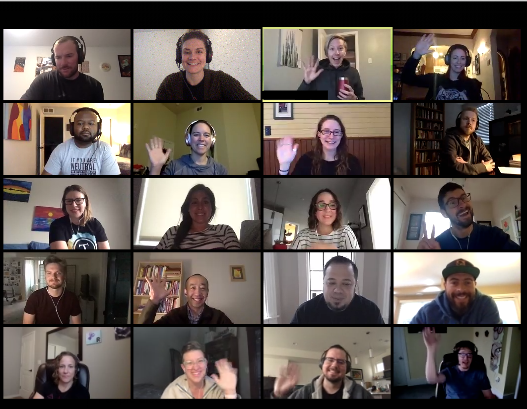 Grid view of people smiling and waving from their laptop camera.