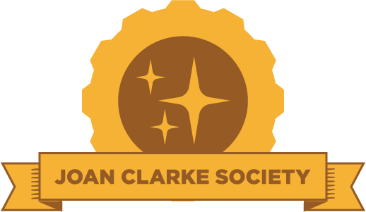 "Yellow gear with an image of a three stars and the phrase ""Joan Clarke Society"" on a banner"